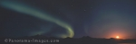 Panoramic photo of an Aurora borealis stream next to the rising moon in the Brooks Range of Alaska, USA.