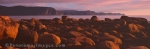 Panoramic photo of sunset over the coastline of Gros Morne National Park on the Northern Peninsula of Newfoundland, Canada.