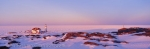 Panoramic sunset photo of the Quirpon Island Lighthouse on the west coast of Newfoundland.