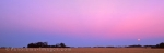 Panoramic photo of a colorful sunset over wheat fields in the canadian province of Saskatchewan, Canada.