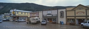 Panoramic photo of the historic buildings which line the streets of Dawson City in the Yukon Territory of Canada.