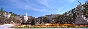 Panoramic photo of the colorful Mirabell Garden in Salzburg, Austria.