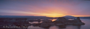 Panoramic photo of a colorful sunset over Lake Powell and Navajo Mountain in Utah, USA