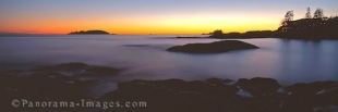 Panoramic photo of Chesterman Beach and the Wickinnish Inn in Tofino on the western shores of Vancouver Island, BC, Canada.