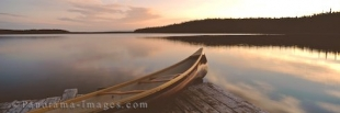Panoramic photo of a canoe on the banks of Tuckamore Lake in Newfoundland, Canada.